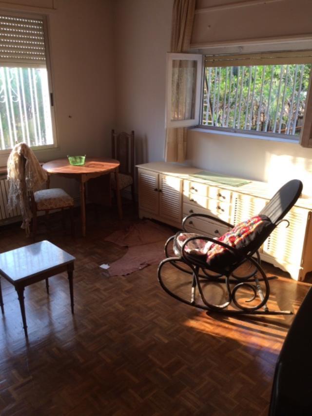 Sala de estar chalet con pinada