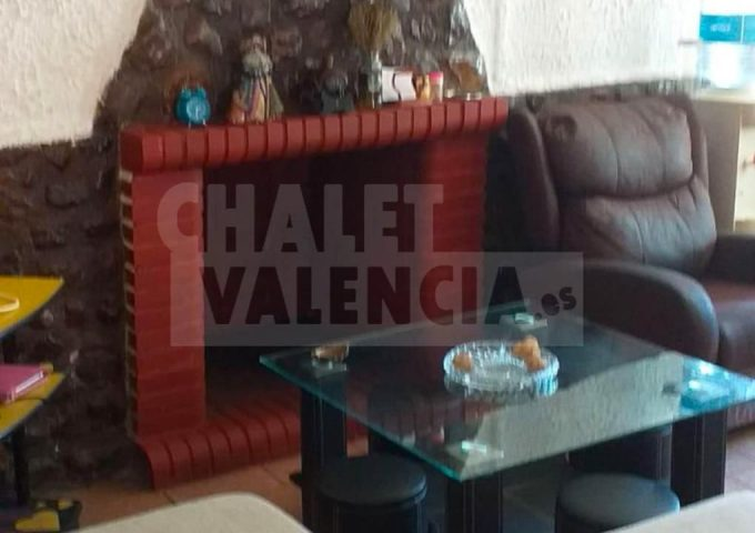 50886-salon-chimenea-montroy-chalet-valencia
